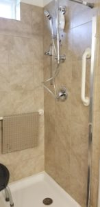 Picture of walk in shower with grab bar at the entrance