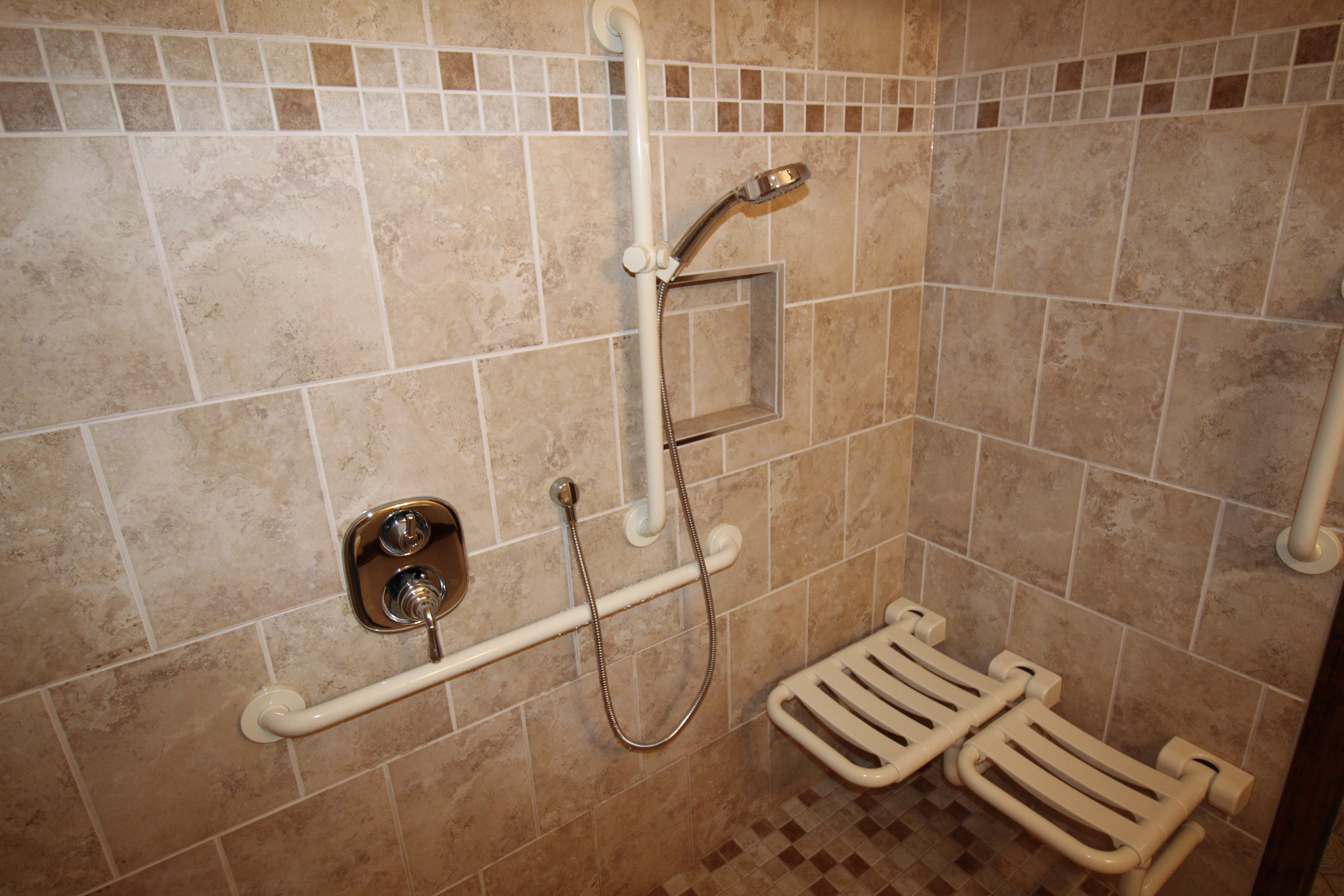 Two grab bars in a tile shower