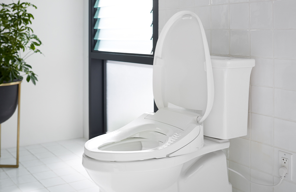 Side view of a bidet toilet seat in the home